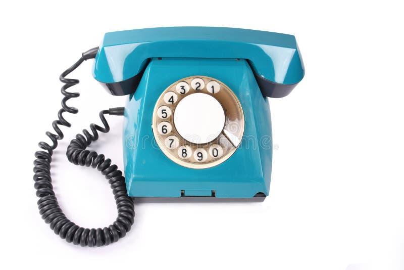 蓝色老电话 库存图片