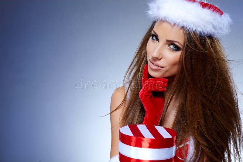 蓝色背景的圣诞老人女孩 库存图片
