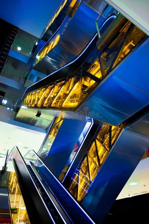 蓝色自动扶梯黄色 图库摄影