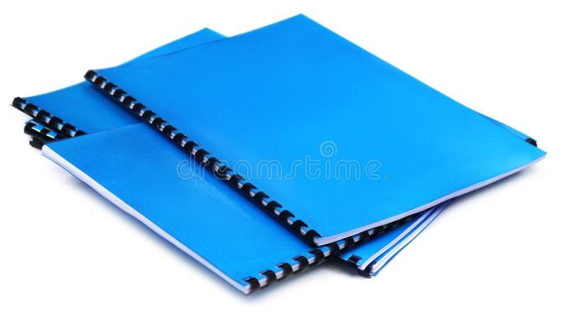 蓝色螺旋装订的笔记本 免版税图库摄影