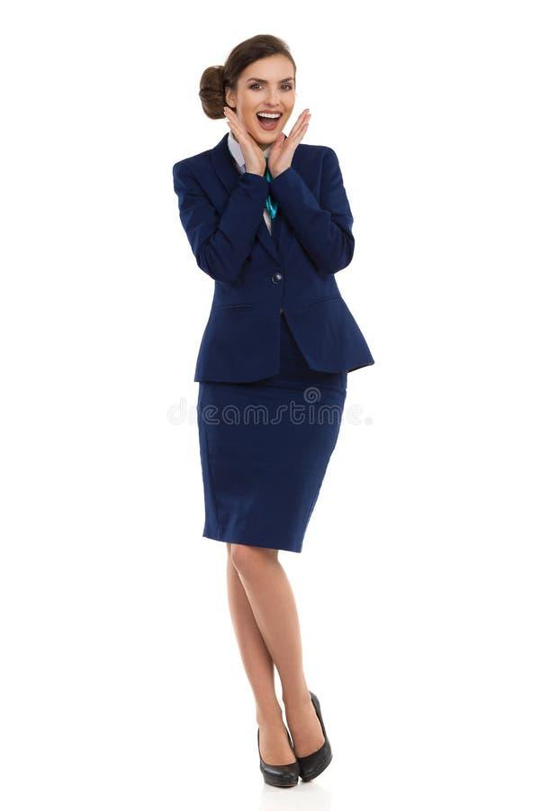 蓝色衣服呼喊的激动的空气空中小姐全长 免版税库存图片