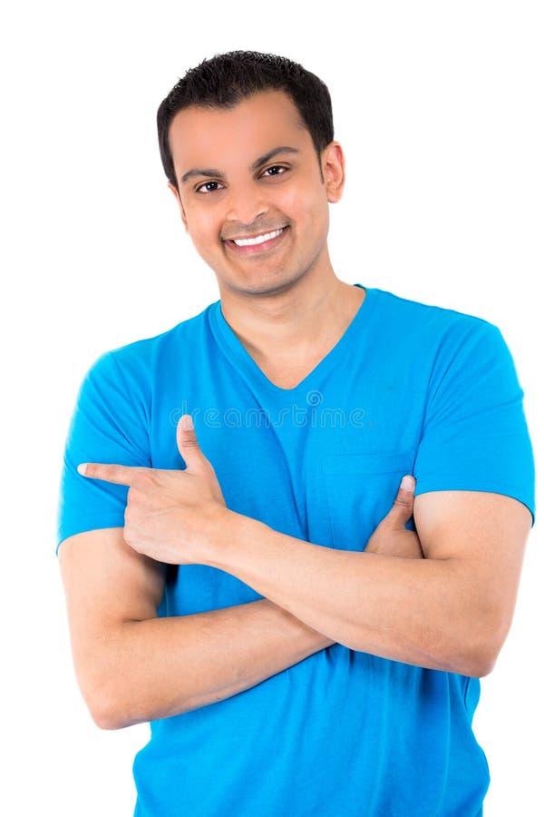 蓝色衬衣指向的英俊的人 免版税图库摄影