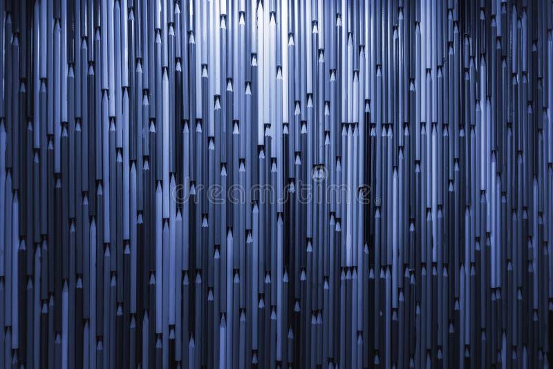 蓝色被定调子的铅笔背景 许多铅笔样式纹理 免版税库存图片