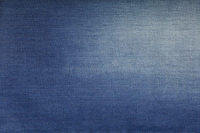 蓝色被洗涤的牛仔裤牛仔布纹理背景 免版税库存图片
