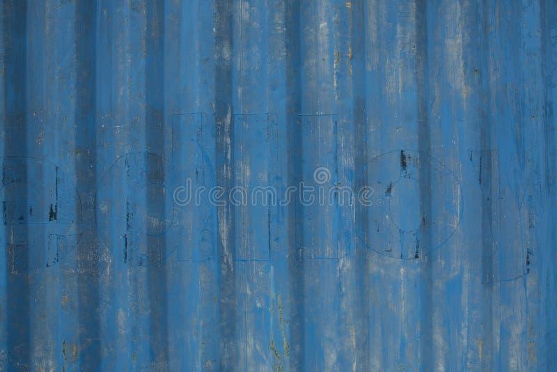 蓝色被绘的金属板背景 库存照片
