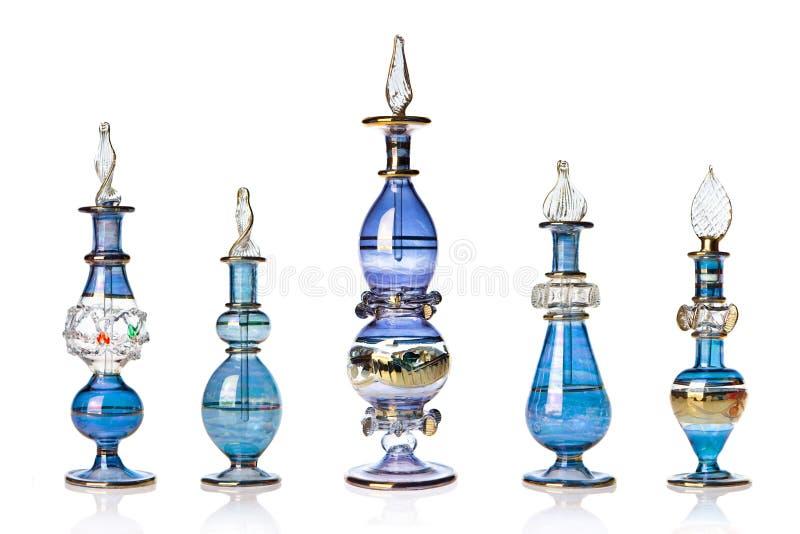 蓝色装瓶东方香水 图库摄影
