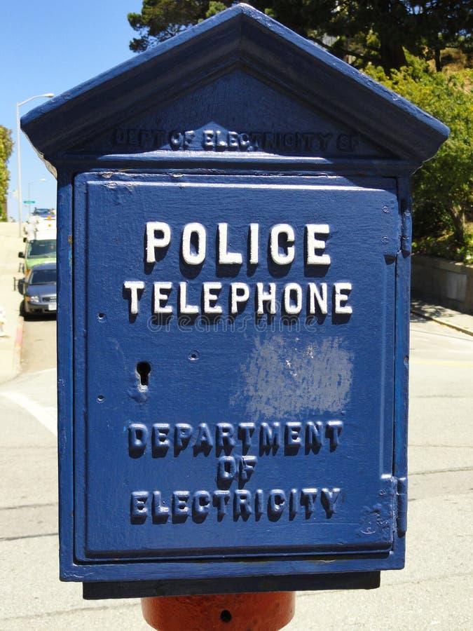 蓝色警察给箱子打电话 免版税库存照片