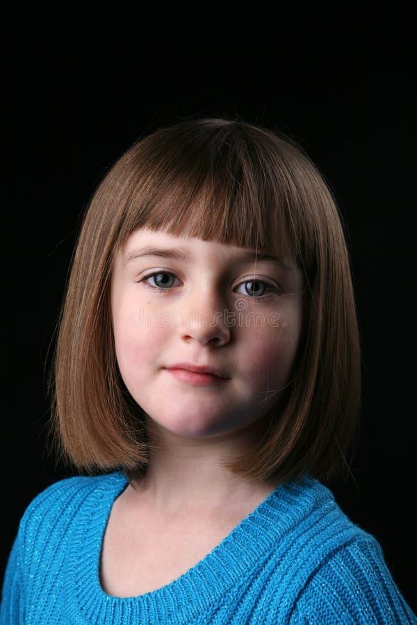 蓝色逗人喜爱的女孩头发少许平直的&# 图库摄影