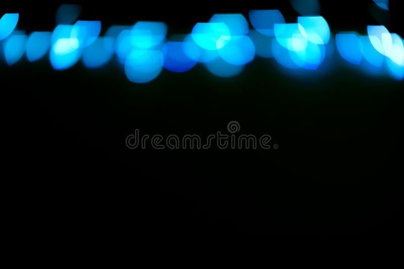 蓝色闪烁点燃背景 defocused 向量例证