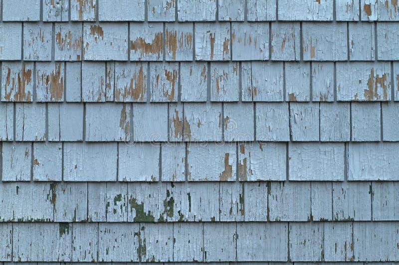 蓝色震动墙壁被风化的木头 库存图片