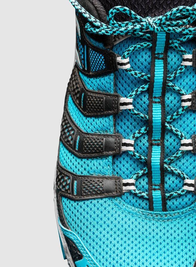 蓝色鞋带特写镜头在灰色的 免版税库存照片
