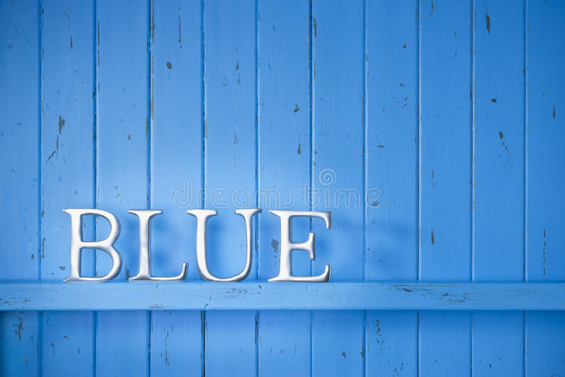 蓝色颜色词背景 免版税库存照片