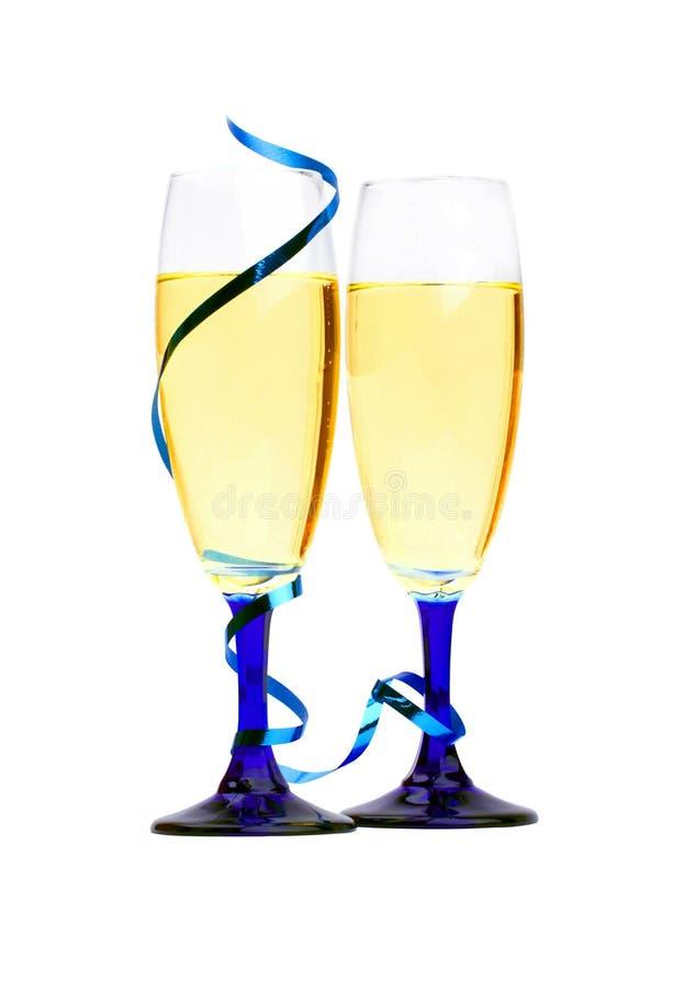 蓝色香槟特写镜头吹奏丝带 免版税图库摄影