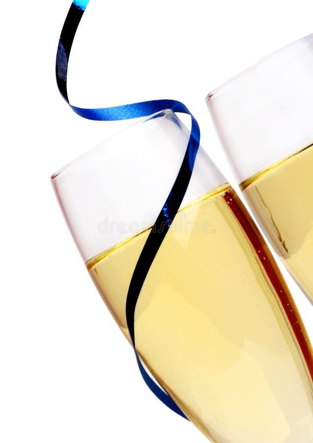 蓝色香槟特写镜头吹奏丝带 库存照片