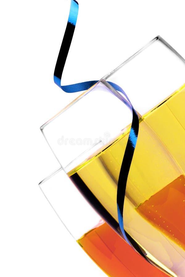 蓝色香槟特写镜头吹奏丝带 免版税库存图片