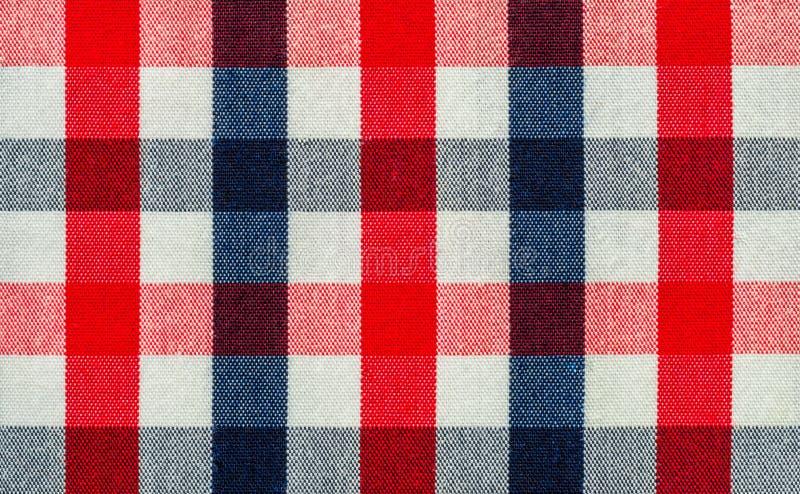 蓝色,红色和白色格子花呢披肩织品 库存照片