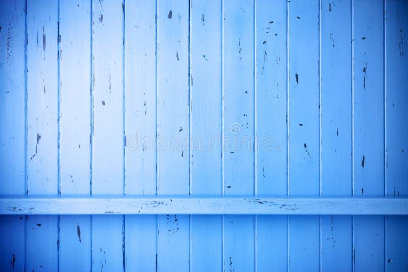 蓝色被绘的木土气背景 库存图片