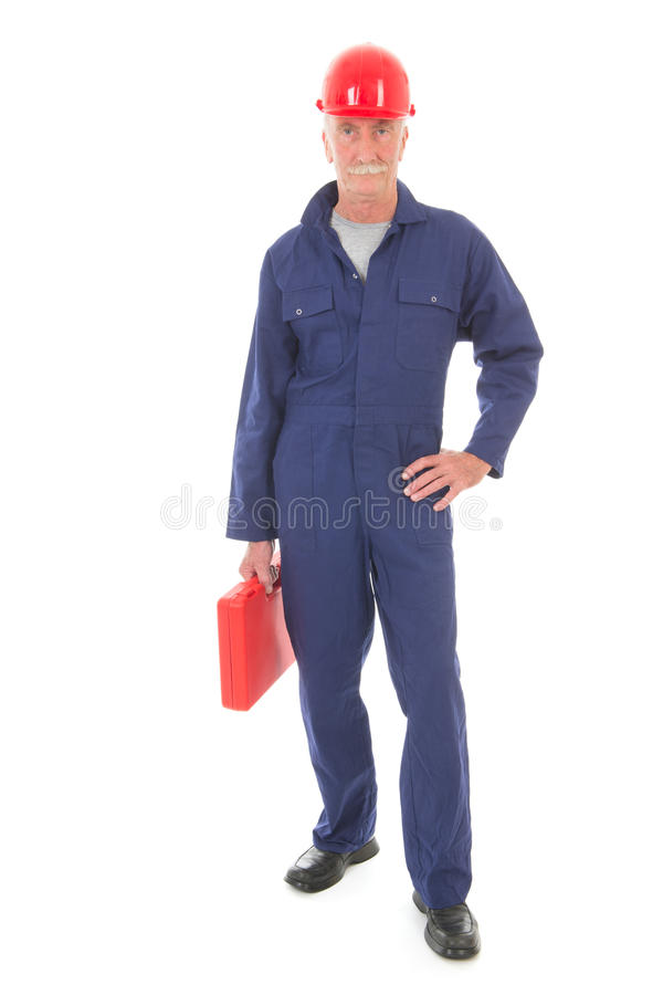 蓝色总体的人带着红色手提箱 图库摄影