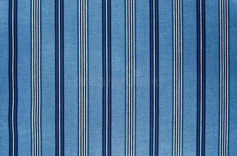 蓝色织品纹理。给背景穿衣 免版税图库摄影
