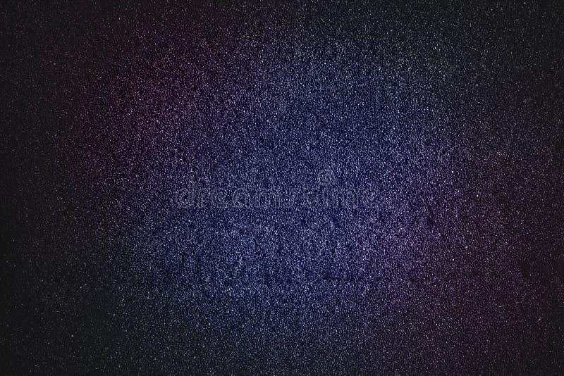 蓝色洋红色抽象纹理有黑口气闪烁背景 图库摄影