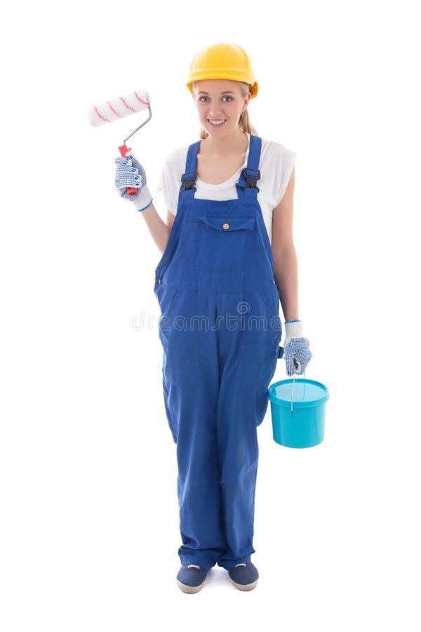 蓝色建造者制服的少妇有画笔和桶的 免版税库存照片