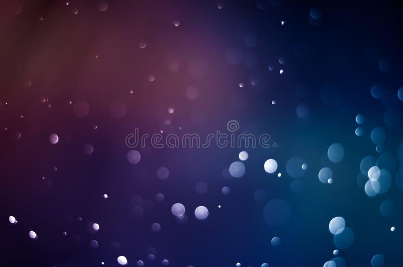 蓝色bokeh摘要背景 桃红色迷离黑暗的紫色 免版税图库摄影