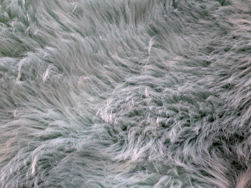 蓝蓝颜色仿制毛皮与一些和起毛现象的 免版税库存照片