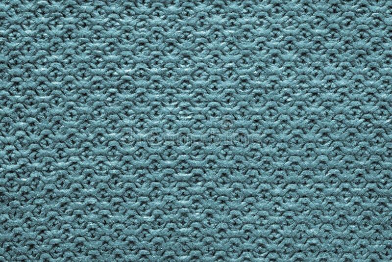 蓝绿色颜色被编织的多孔的纹理  图库摄影