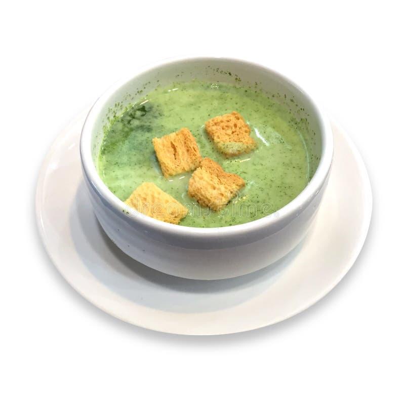 蔬菜汤,绿色用在白色背景的面包 库存照片