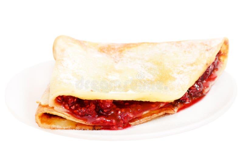 薄煎饼用在牌照的山莓果酱 库存照片
