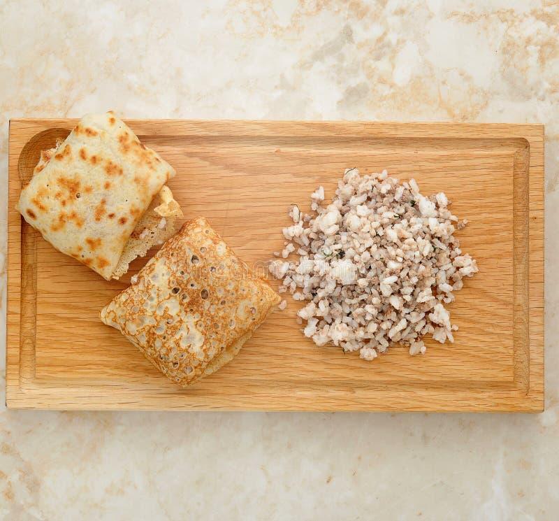 薄煎饼用肉和米 图库摄影