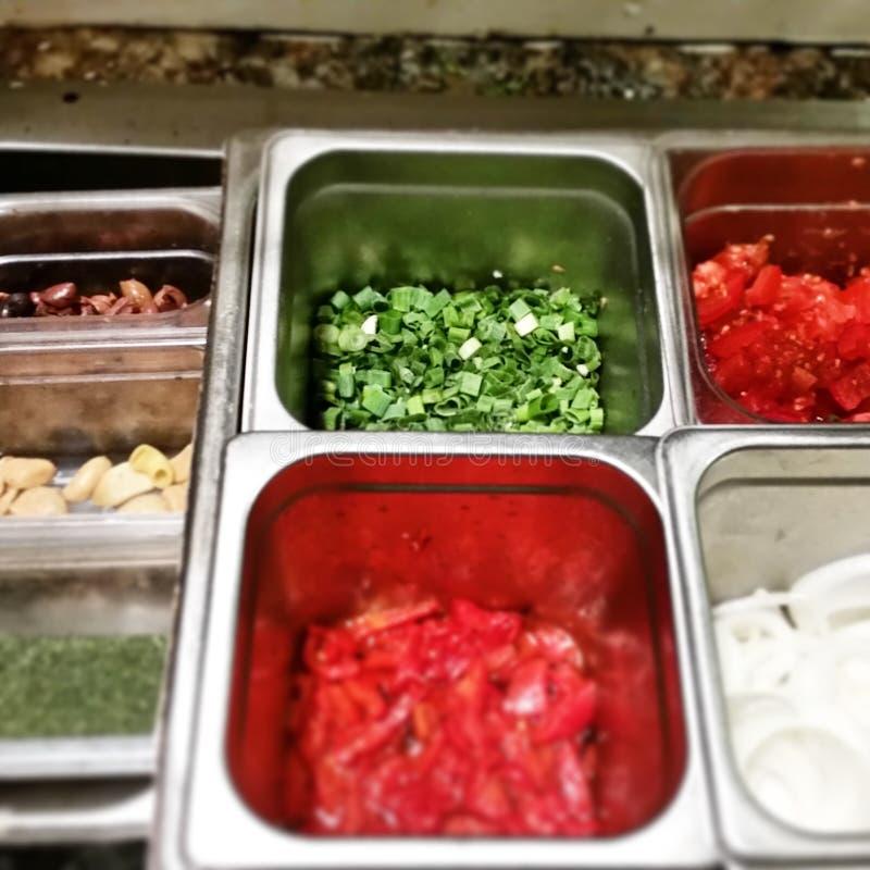 薤和红色甜椒 免版税库存照片