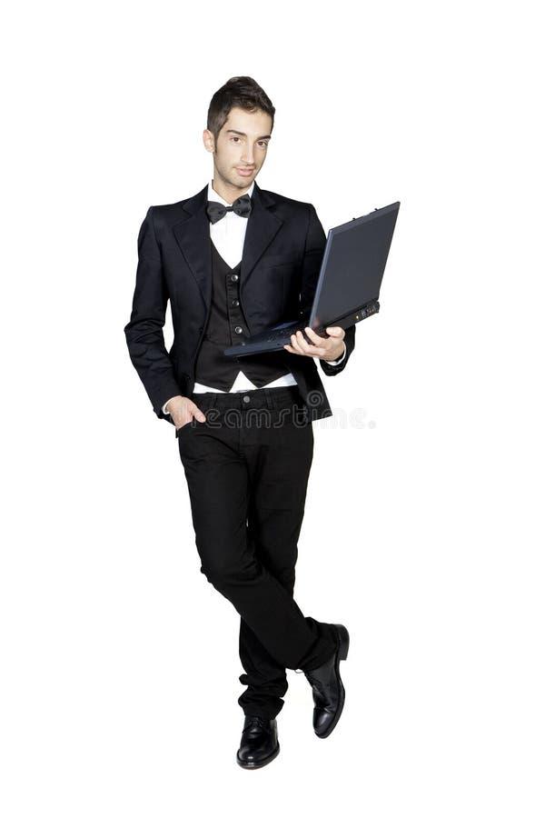 藏品膝上型计算机人时髦的无尾礼服&# 图库摄影