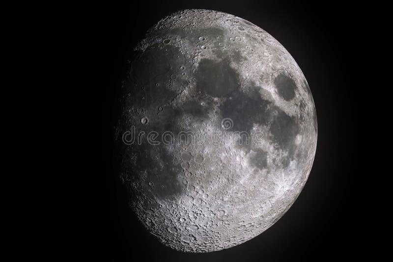 虚度与月亮表面的轻的阴影的阶段与火山口的在黑背景、宇宙和科学 免版税库存图片