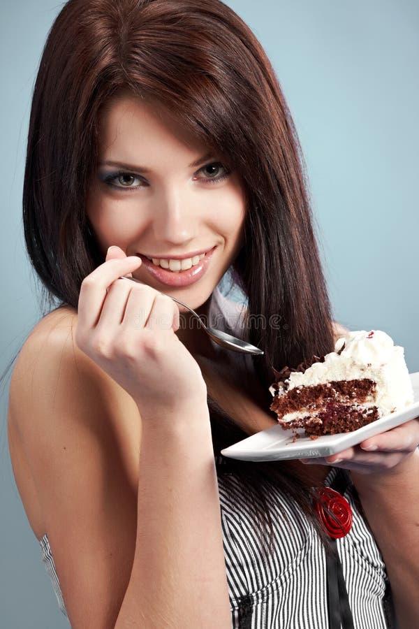 蛋糕吃片式甜点妇女 图库摄影