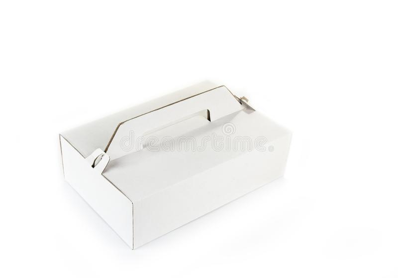 蛋糕或外卖食品的被折叠的纸板箱 库存照片