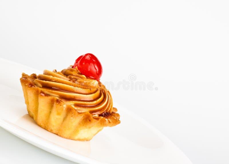 蛋糕樱桃盘 库存照片
