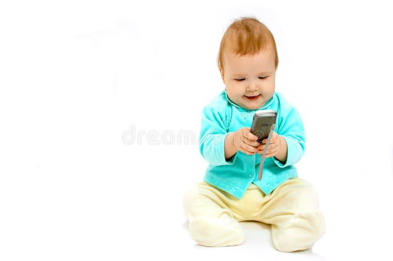 蜂窝电话的婴孩 免版税库存照片