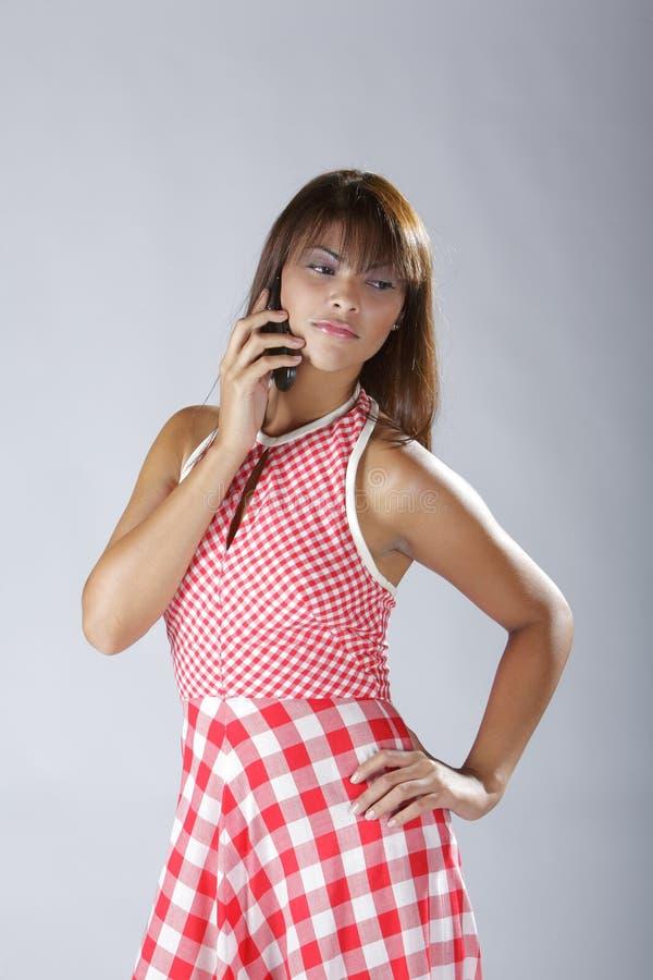 蜂窝电话西班牙夫人电话性感联系 库存照片