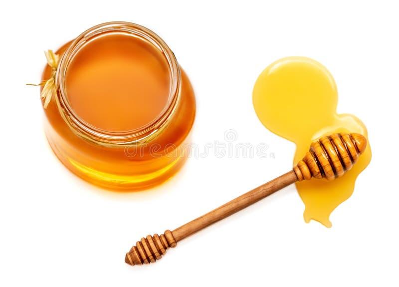 蜂蜜浸染工和蜂蜜在白色背景隔绝的瓶子 Natu 库存图片