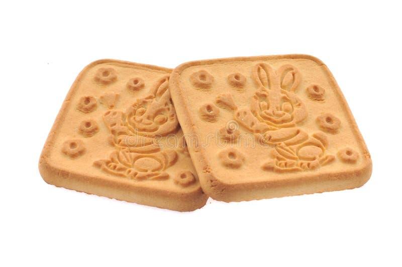 蜂蜜,查出的牛奶曲奇饼 图库摄影