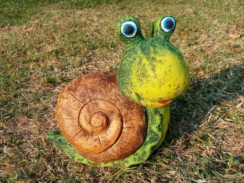 蜗牛庭院装饰 免版税库存照片