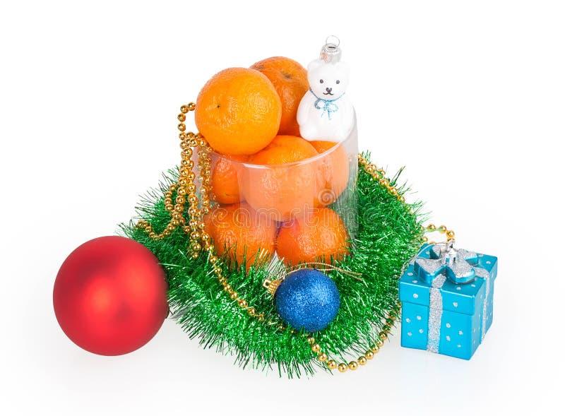 蜜桔和圣诞节玩具 免版税图库摄影