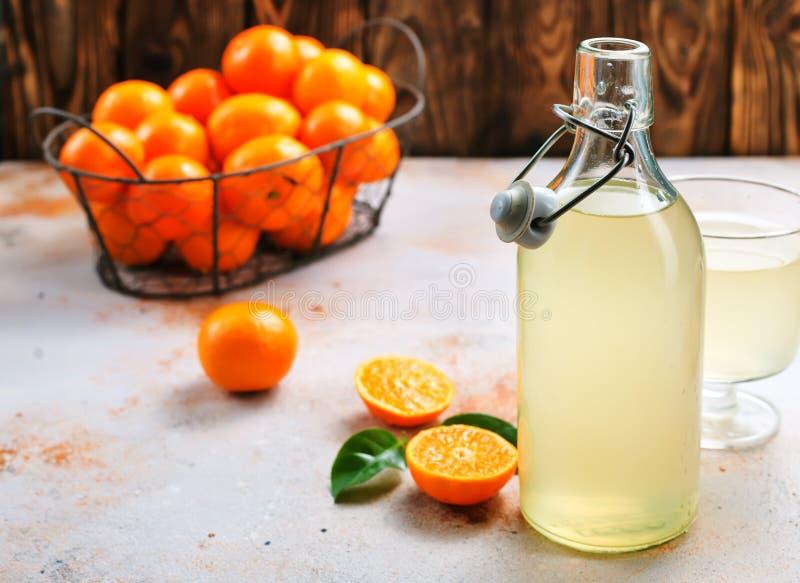 蜜桔和蜜桔汁 库存照片