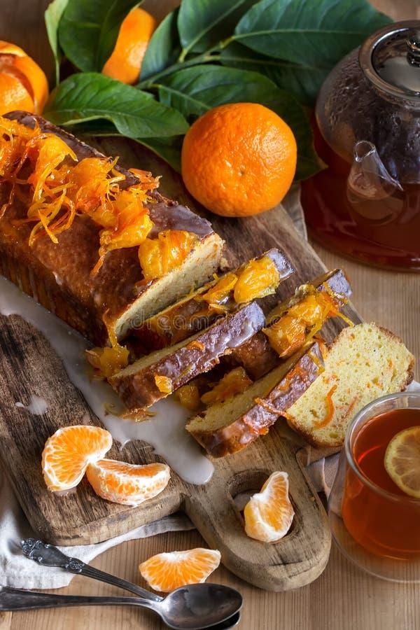 蜜桔蛋糕用茶 免版税库存图片