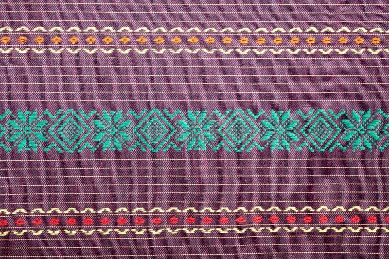 蜡染布布裙泰国,传统蜡染布saron的织品样式 库存照片