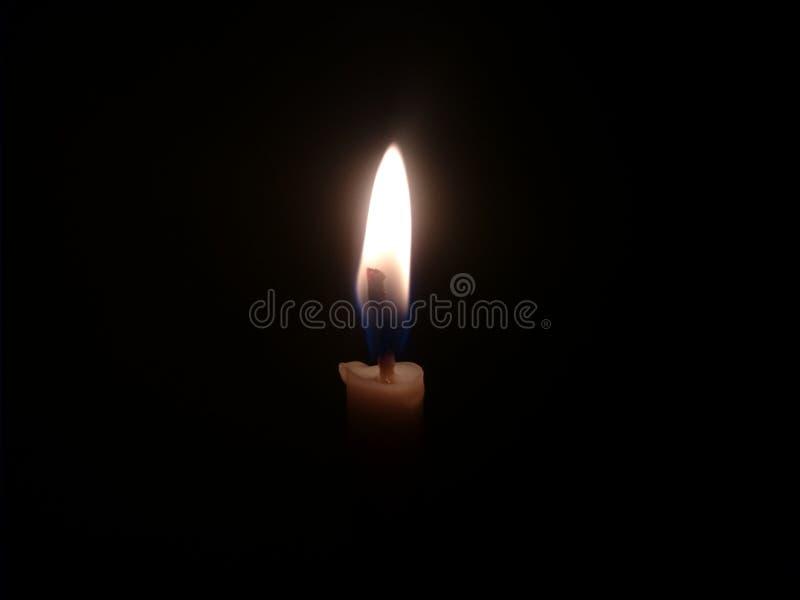 蜡烛光有黑背景 库存照片
