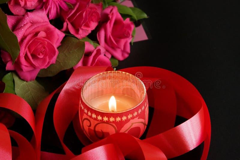 蜡烛桃红色玫瑰 免版税库存照片