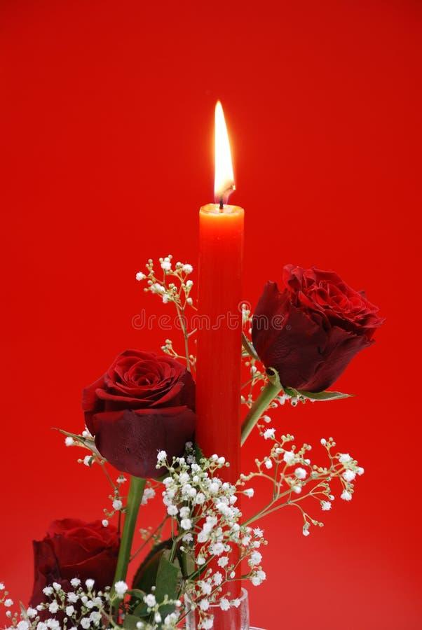 蜡烛红色玫瑰 免版税库存照片