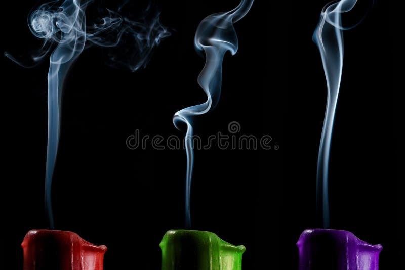 蜡烛红色绿色和紫色颜色 库存图片